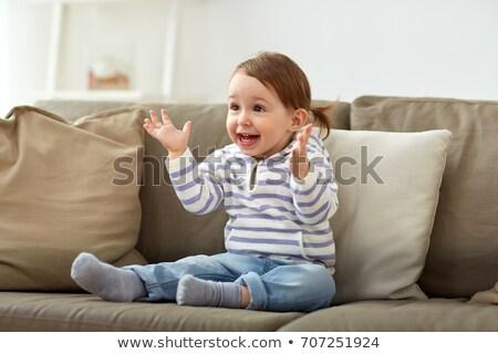 Boldog mosolyog kislány ül kanapé otthon Stock fotó © dolgachov