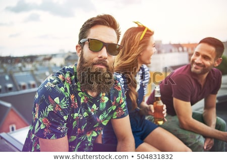 Man sitting on urban rooftop Stock photo © IS2