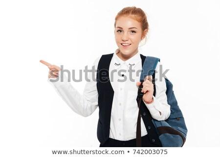 улыбаясь студент женщину рюкзак указывая далеко Сток-фото © deandrobot