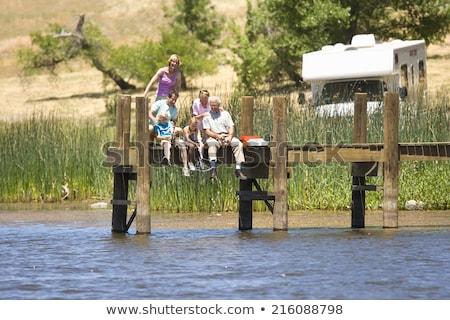 Senior couple holding fishing rod Stock photo © IS2