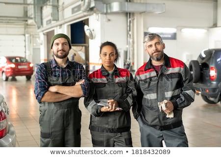 Três trabalhadores garagem retrato carro em pé Foto stock © IS2