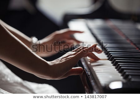 Young woman playing piano with man Stock photo © IS2