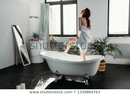 Young woman standing by the window in spa center Stock photo © boggy