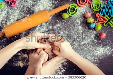 hands of mother and daughter preparing biscuits stock photo © choreograph