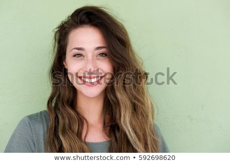 close up portrait of a smiling young woman stock photo © deandrobot