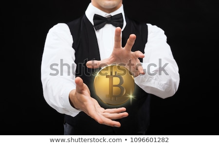 Stock photo: close up of magician with bitcoin over black