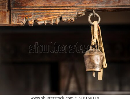 Old gold bell in buddhist temple. Stock photo © galitskaya