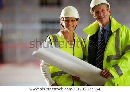 Team volwassen vrouwen mannen bespreken blauwdruk Stockfoto © frimufilms