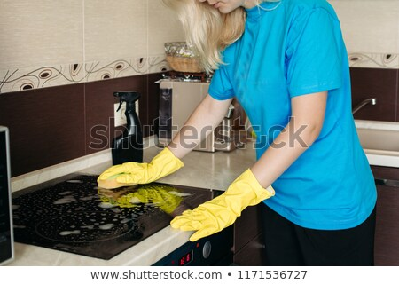 mujer · rubia · guantes · trapo · limpieza · eléctrica - foto stock © studiolucky
