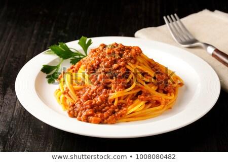 espaguetis · original · italiano · albahaca · aceitunas · negras · tenedor - foto stock © karandaev