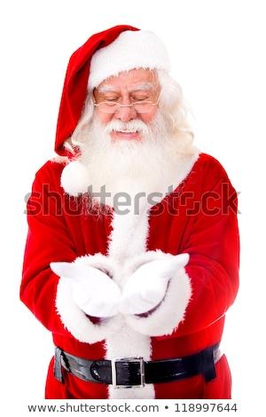 happy man in santa hat holding something imaginary Stock photo © dolgachov