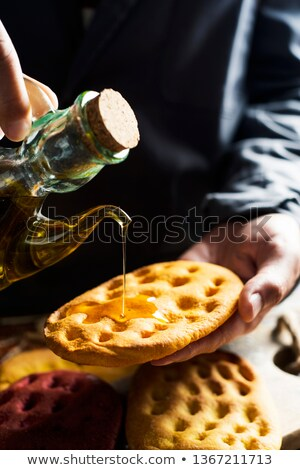 man dressing with olive oil an italian focaccia Stock photo © nito