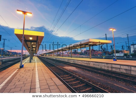 modern railway station at night in europe industrial landscape stock photo © denbelitsky
