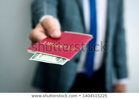 Imprenditore 20 dollari passaporto primo piano giovani Foto d'archivio © nito