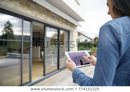 Stockfoto: Person Using Home Control System On Laptop