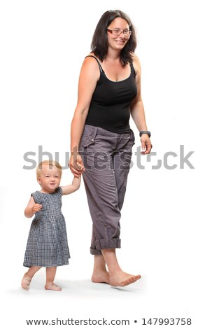 baby girl learning to walk with the help of her mother stock photo © lopolo