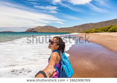 galapagos tourist having fun on travel on espumilla beach santiago galapagos stock photo © maridav