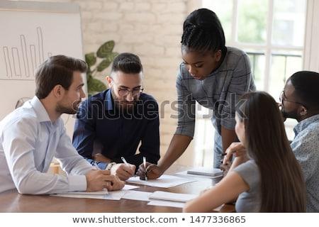 Homem de negócios discutir financeiro analista negócio desenvolvimento Foto stock © Freedomz
