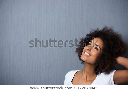 Pretty afro girl daydreaming Stock photo © nyul