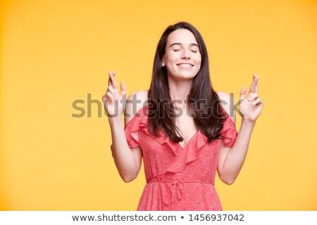 Mutlu esmer kız kırmızı elbise parmaklar gözleri kapalı Stok fotoğraf © pressmaster