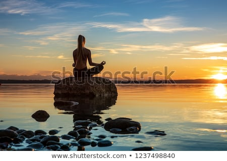 Woman Meditation In Mountains Stock photo © AndreyPopov