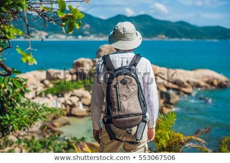 Man traveler look at Hon Chong cape, Garden stone, popular tourist destinations at Nha Trang. Vietna Stock photo © galitskaya