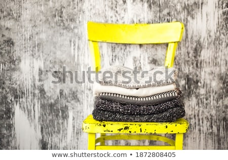 Pile of knitted warm grey and white blankets, scarves and woolen Stock photo © dashapetrenko