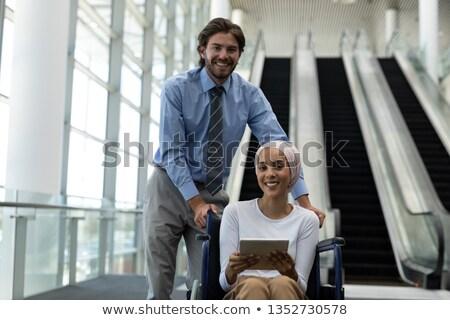 портрет довольно инвалидов молодые женщины исполнительного Сток-фото © wavebreak_media