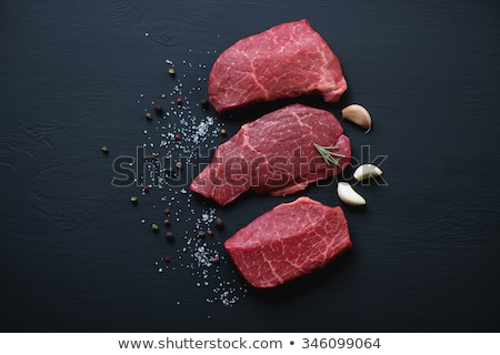 Close-up of beef red meat with black pepper Stock photo © dariazu