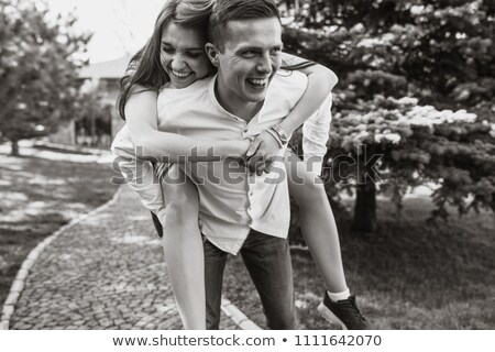 Two friends in the summer in the Park have fun and frolic outdoors Stock photo © ElenaBatkova