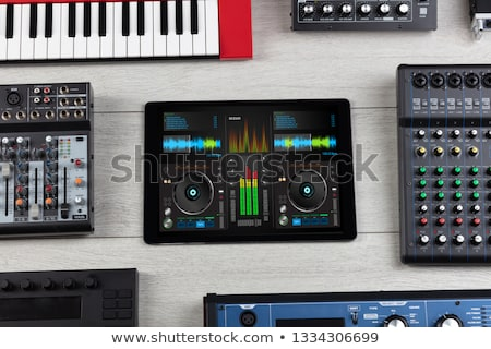 Piano app on tablet and musical instrument concept Stock photo © ra2studio