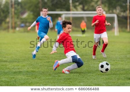 Kinderen spelen voetbal spel kinderen outdoor Stockfoto © matimix