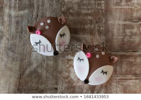 Cute deer cupcakes on wooden table Stock photo © dashapetrenko
