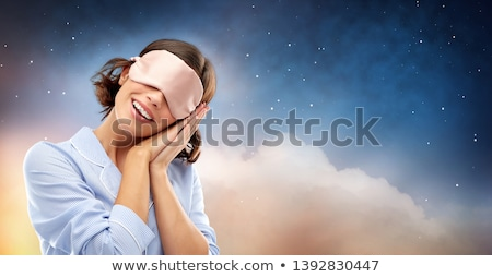 happy woman in pajama over night sky background Stock photo © dolgachov