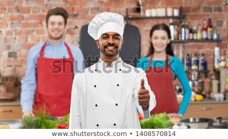 indian chef showing thumbs up at cooking class Stock photo © dolgachov