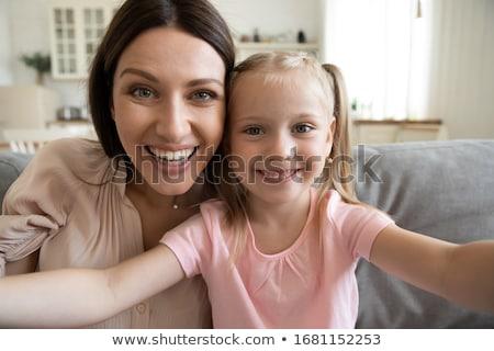 Zsákmányolás öröm boldogság élvezet boldog lány ibolya Stock fotó © robuart