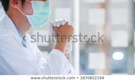 The medical team and quarantine control coronavirus covid-19 are praying to God requesting that the  Stock photo © user_15523892