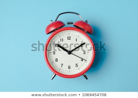 Red Alarm Clocks on Light Blue Background Stock photo © make