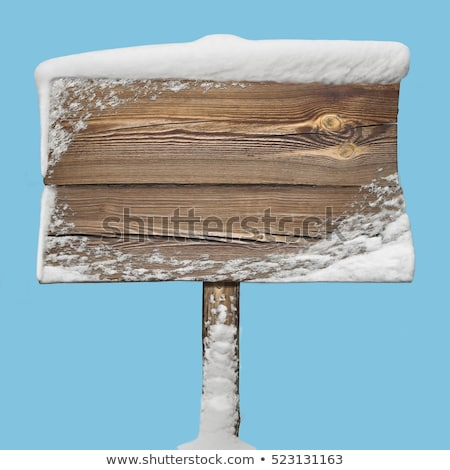 Wooden direction sign with snow on it and with snowfall on background Stock photo © galitskaya