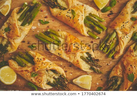 Grilled green asparagus and cheese puff pastry folded as envelope and topped with black sesame Stock photo © dash