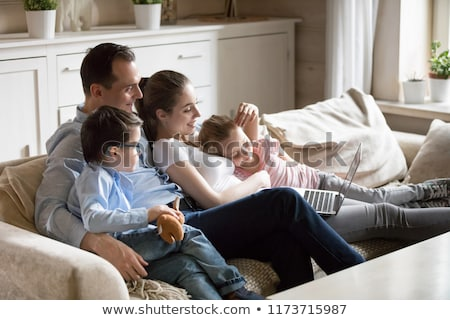 Stock photo: Family of four on a sofa