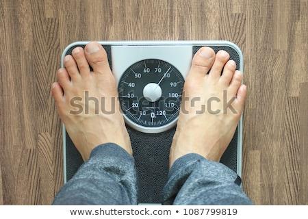 Homem peso escala surpreendido isolado branco Foto stock © kokimk