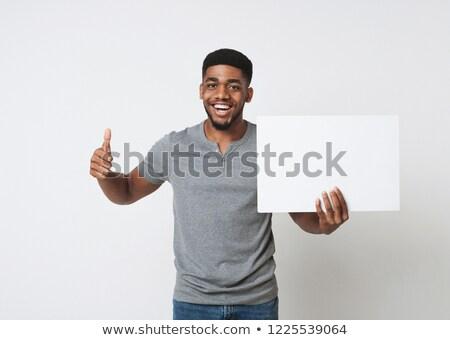 Fiatal férfiak magasra tart üres tábla barátok felirat férfiak Stock fotó © photography33
