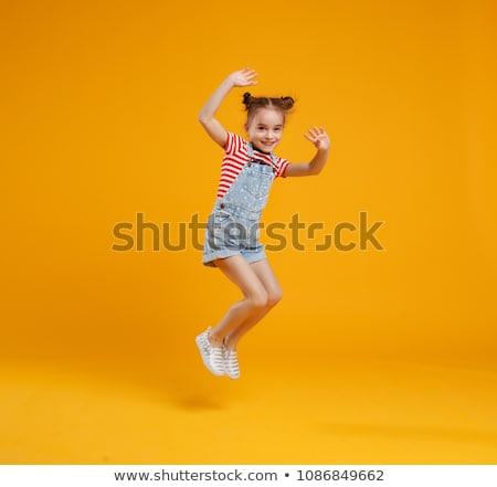 jovem · little · girl · saltando · alegria · sala · de · estar · menina - foto stock © get4net