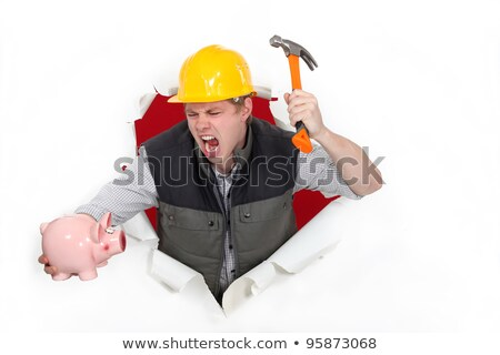 Tradesman about to smash a piggy bank Stock photo © photography33