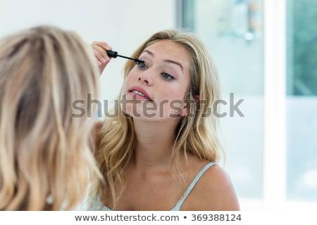 Stock foto: Woman Putting Mascara Makeup