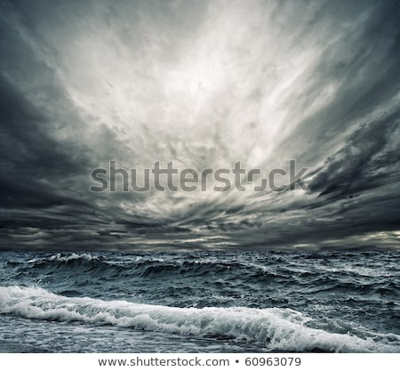 dark cloudy stormy sky with clouds and waves in the sea Stock photo © vkraskouski