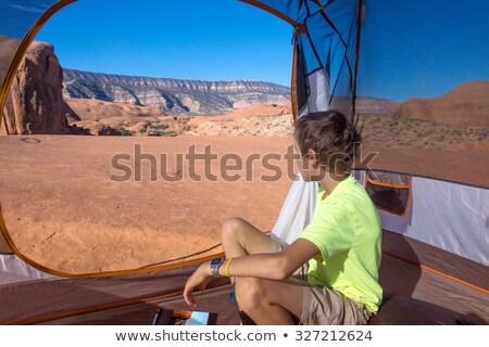 Boy sitting in a rocky area Stock photo © lovleah