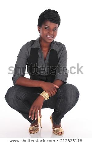Female entrepreneur crouching on white background Stock photo © photography33