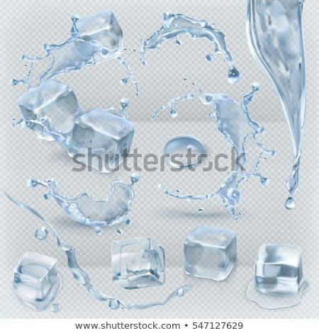 Сток-фото: Ice Cube Falling Into Water